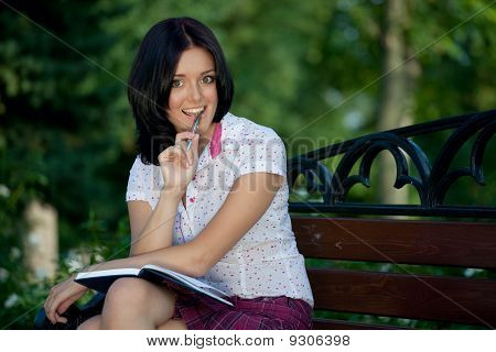 Girl Sudying In Park