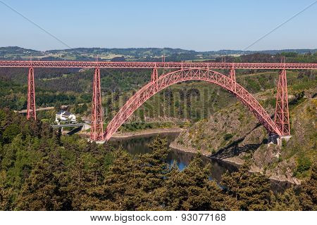 Historic iron railway arch bridge - The Garabit Viaduct - through the River Truyere was built 1884 by the famous french engineer Gustave Eiffel poster