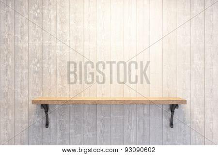 empty book shelf on wooden wall