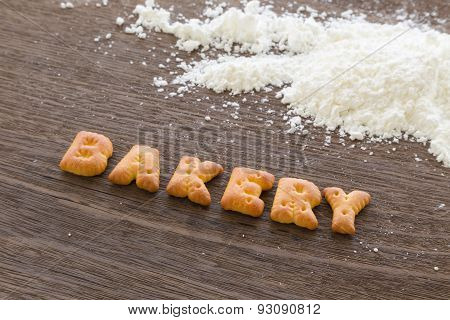 Word BAKERY Alphabet Biscuits On Wood Table