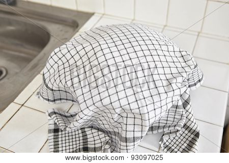 Rising bread dough being covered with cloth