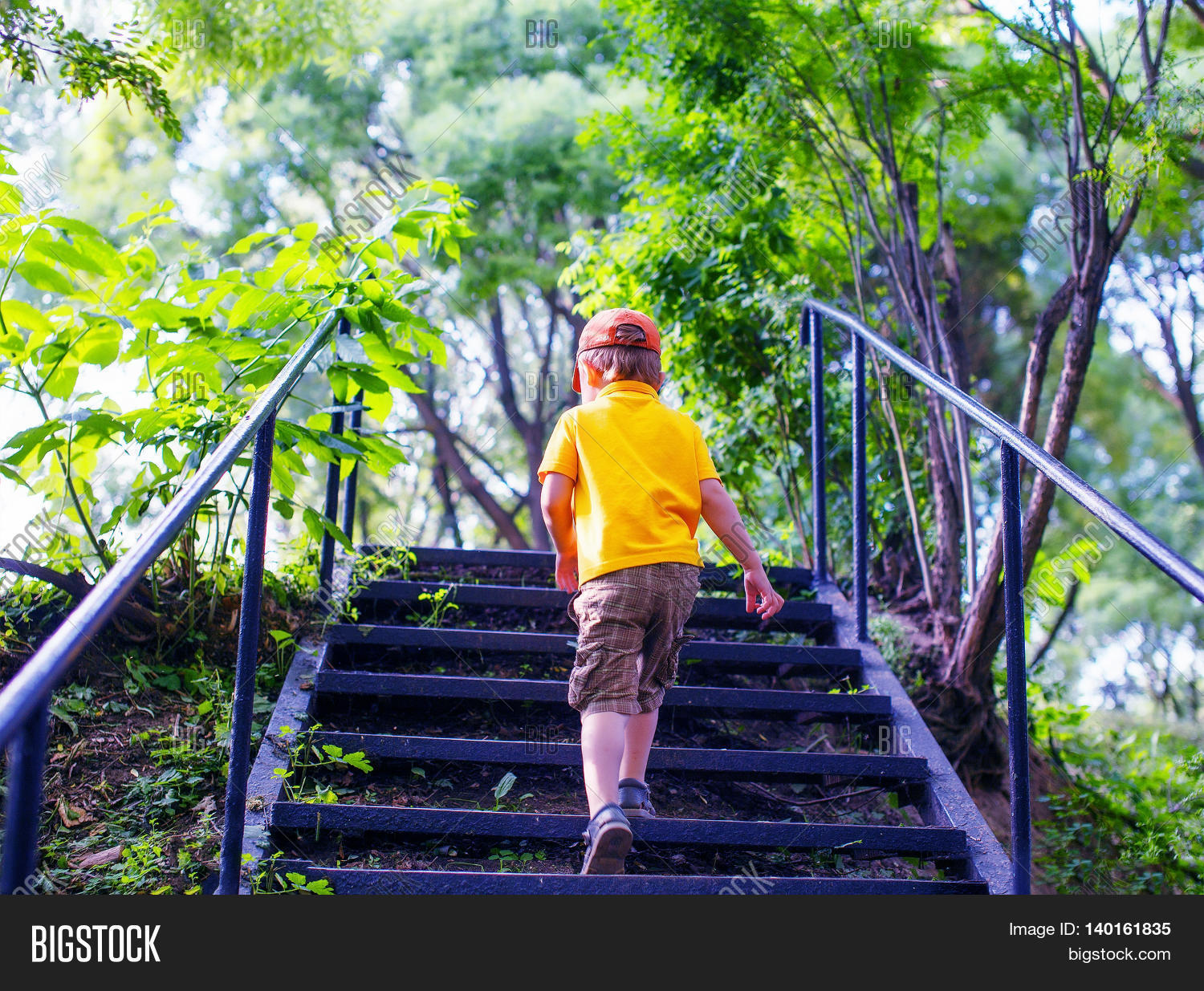 Toddler Climbs The Stairs In The Park. Concept Of Growing Up. Step By Step
