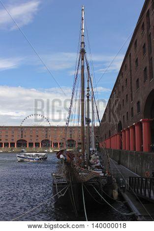 LIVERPOOL, ENGLAND, JULY 2. Albert Dock on July 2, 2016, in Liverpool, England. Liverpool landmarks include Albert Dock the Big Wheel ferris wheel Skylark Boat Trips and the Tate Art Museum.