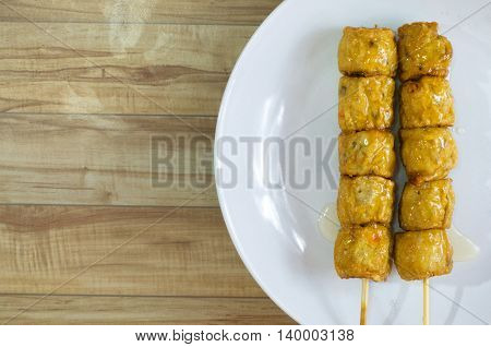 Food made with a mixture of pork  chicken egg.