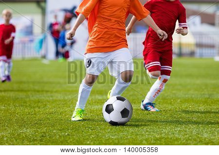 Children playing soccer football match. Running players and kicking soccer ball. Sport school tournament for youth soccer teams