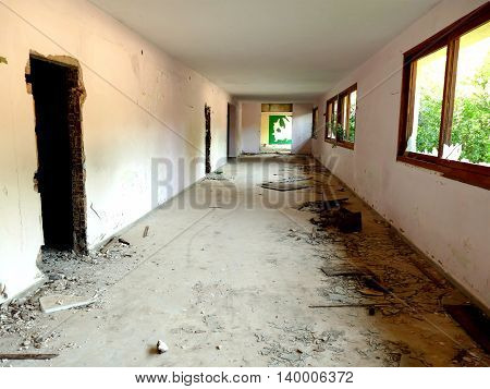 Remains of deserted Saladi beach resort in Peloponnese. A former hotel for nudists closed under pressure of the church. Corridor view with debris.