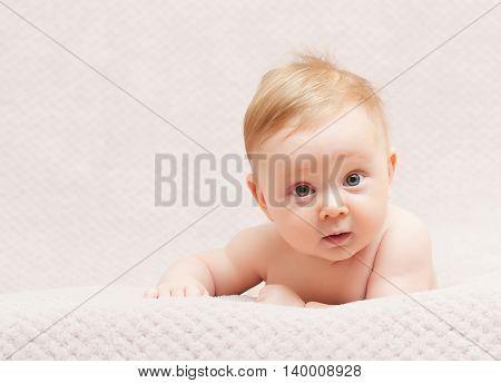 portrait of caucasian newborn with pink flower woolen hat