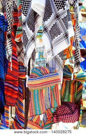 Arab keffiyeh on display in a store at the market in Demre, Turkey