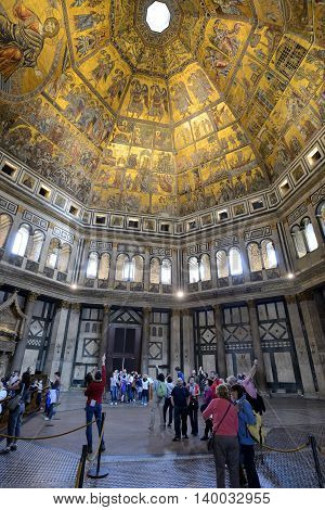 FLORENCE, ITALY - APRIL 27: Tourists inside of The Florence Baptistery (Baptistry of St. John) on April 27, 2013 in Florence. It is one of the oldest buildings in the city.