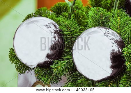 Christmas decorations. Silver glossy holiday toy balls.