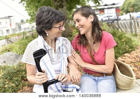 Senior disabled woman and carer spending time together