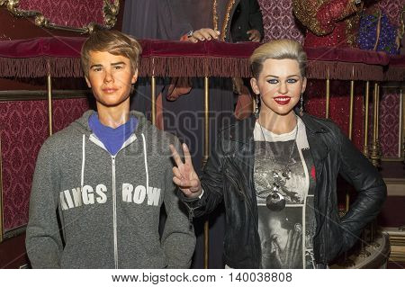 MADRID,SPAIN-MARCH 2016:Justin Bieber and Miley Cyrus   wax figures in Madame Tussauds Museum