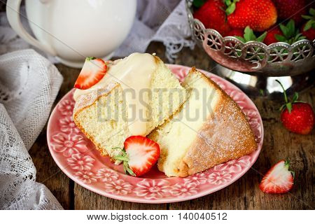 Homemade sponge cake with strawberry and cream. Delicious dessert cake with fresh berries selective focus