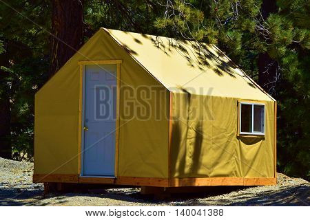 Modern and rustic tent cabin taken in a rural forest at Mt Baldy, CA