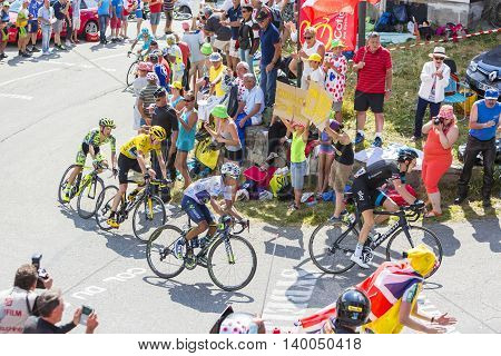 Col du Glandon France - July 23 2015: A group of favorites cyclists riding in a beautiful curve at Col du Glandon in Alps during the stage 18 of Le Tour de France 2015.