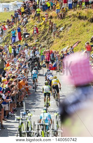 Col du Glandon France - July 23 2015: Point of view of a spectator from the crowd over a group of favorites cyclists riding on the road to Col du Glandon in Alps during the stage 18 of Le Tour de France 2015.