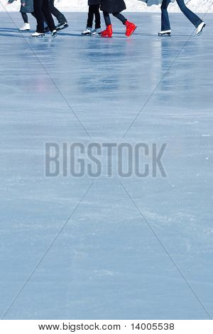 Skaters on ice surface