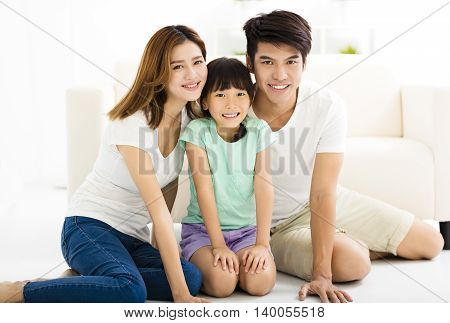 Happy Attractive Young Family and little girl
