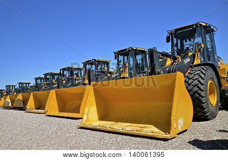 MOORHEAD, MINNESOTA, July 25, 2016: The new huge wheel loaders are products of John Deere Co, an American corporation that manufactures agricultural, construction, forestry machinery, diesel engines, and drivetrains.