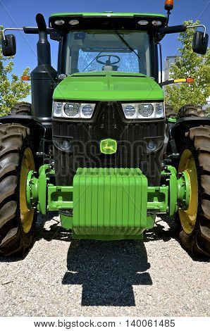 MOORHEAD, MINNESOTA, July 25, 2016: The new tractor with front end weights is a product of John Deere Co, an American corporation that manufactures agricultural, construction, forestry machinery, diesel engines, and drivetrains.