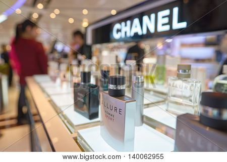 HONG KONG - MAY 12, 2016: a bottle of Chanel perfume in a store. Chanel S.A. is a high fashion house that specializes in haute couture and ready-to-wear clothes, luxury goods and fashion accessories