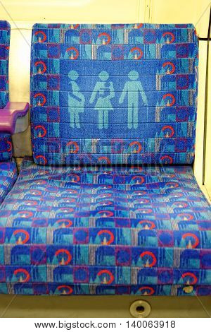 LONDON UK - JULY 1 2014: A seat on a train for elderly disabled pregnant people carrying children or those less able to stand.
