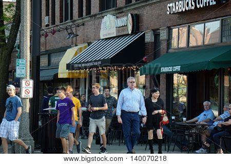 LA GRANGE, ILLINOIS / UNITED STATES - MAY 21, 2016: One may eat Dinico's pizza, Trugurt yogurt, and drink Starbucks coffee in downtown La Grange, Illinois.