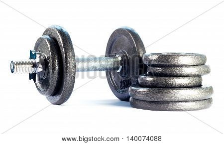 Steel folding dumbbell and discs dumbbell isolated