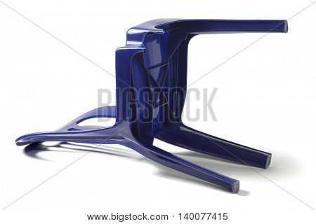 Plastic Chair with Broken Leg Lying on White Background