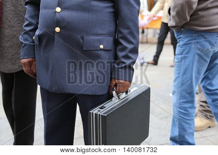 Cop With A Suitcase With Many Secret Documents