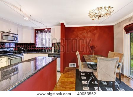 Dining Area Connected To Kitchen With Red Walls, Vintage Chandelier.
