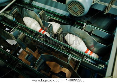 Bowling pins at bowling machine room engine
