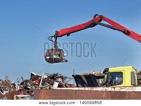 Metal Scrap Yard With Grabber