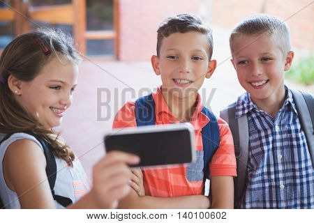Schoolkids taking selfie from mobile phone at school