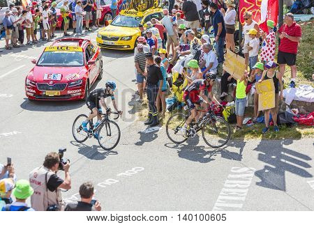 Col du Glandon France - July 23 2015: Samuel Sanchez Gonzalez of BMC Racing Team and Leopold Konig of Team Sky riding in a beautiful curve at Col du Glandon in Alps during the stage 18 of Le Tour de France 2015.