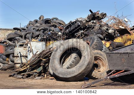 Tires And Metal Scraps On Pile