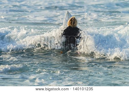 Surfing Surfer paddle out ocean wave white water morning encounter