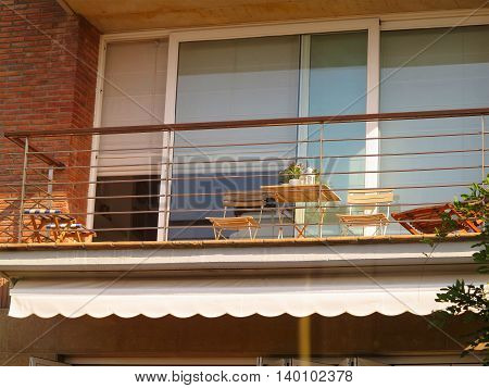 Beautiful terrace or balcony with small table chairs and flowers