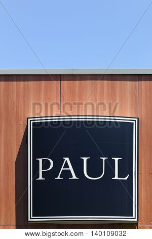Masseret, France - June 23, 2016: Paul logo on a wall Paul is a French chain of bakery café restaurants established in 1889 in France. It specializes in serving French products including breads, sandwiches, macarons, cakes, pastries