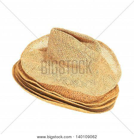 Set of straw hats isolated on white background.