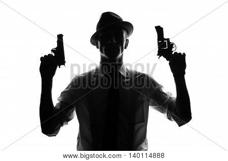 Silhouette of a private detective with two guns in both hands
