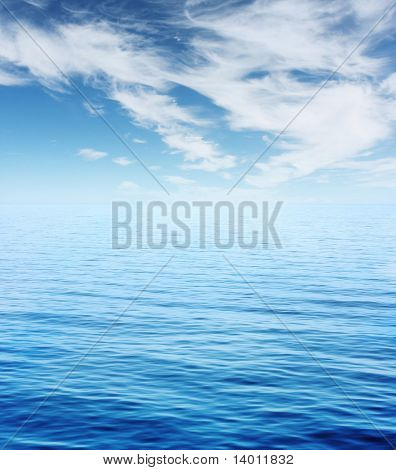 Blue sea and sky with clouds