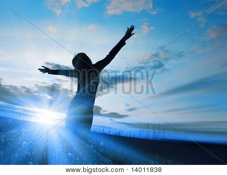 Blue light and young woman in field