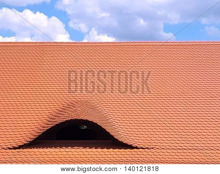 Wavy Rooftop Covered In Orange Brown Terracotta Tiles