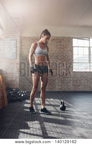 Strong Young Woman In Sportswear At Gym