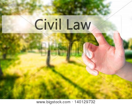 Civil Law - Hand Pressing A Button On Blurred Background Concept On Visual Screen.