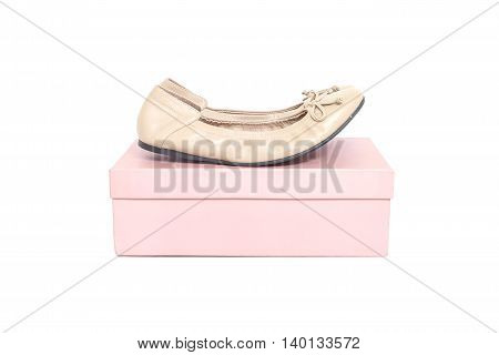 Closeup brown woman shoes on pink paper box of shoes isolated on white background
