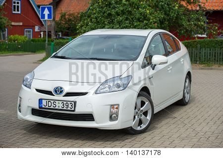 NIDA - JULY 24: Toyota Prius on July 24, 2016 in Nida, Lithuania. The Toyota Prius is a full hybrid electric mid-size hatchback, formerly a compact sedan, developed and manufactured by Toyota.