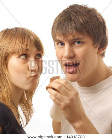 Avid man with food and angry woman