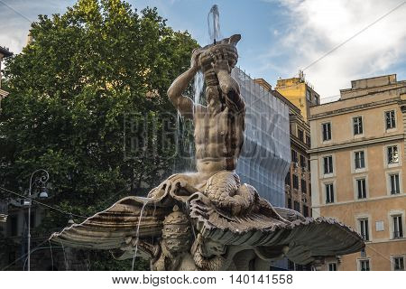 Rome, Italy. Triton Fountain at Barberini square. Fontana del Tritone at Piazza Barberini was sculpted by Bernini around 1642 AD.